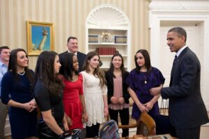 President Barack Obama talks with members of the 2012 U.S. Olympic gymnastics teams in the Oval Office, Nov. 15, 2012. Pictured, from left, are: Steven Gluckstein, Savannah Vinsant, Aly Raisman, Gabby Douglas, Steve Penny, USA Gymnastics President, McKayla Maroney, Kyla Ross, and Jordyn Wieber. (Official White House Photo by Pete Souza) This official White House photograph is being made available only for publication by news organizations and/or for personal use printing by the subject(s) of the photograph. The photograph may not be manipulated in any way and may not be used in commercial or political materials, advertisements, emails, products, promotions that in any way suggests approval or endorsement of the President, the First Family, or the White House.Ê